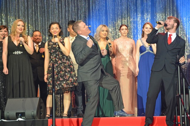 """An ensemble group from U.S. Army Garrison Italy's Soldiers' Theater perform a medley from """"Disaster, the Musical,"""" at the 2019 Toppers April 27 at the USAG Wiesbaden fitness center. Toppers celebrates the best in theater across military communities in Europe."""