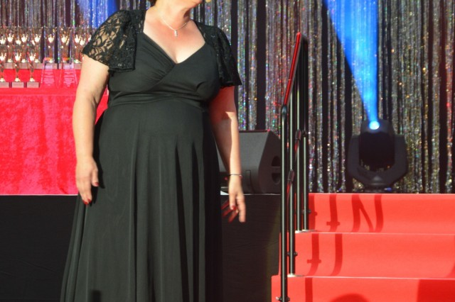 """Trude Moellman, from U.S. Army Garrison Ansbach's The Ansbach Terrace Playhouse, performs """"When You're Good to Mama,"""" from """"Chicago,"""" at the 2019 Toppers April 27 at the USAG Wiesbaden fitness center. Toppers celebrates the best in theater across military communities in Europe."""