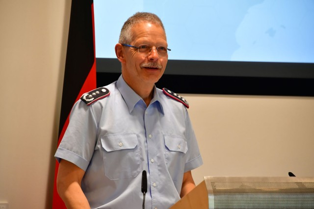 GARMISCH-PARTENKIRCHEN, Germany (April 26, 2019) -- German Air Force Col. (GS) Jörg Kunze, executive course director of the Marshall Center's Seminar on Regional Security Studies, prepares the 38 participants from 23 nations for a practical exercise by examining the Syrian War during the Marshall Center's Seminar on Regional Security Studies April 26. (DOD photo by Master Sgt. Corey Dennis/RELEASED).