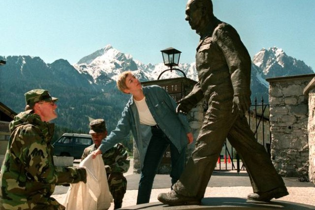 GARMISCH-PARTENKIRCHEN, Germany - Bavarian Artist, Christiane Horn of Wartenberg, Germany, unveils the bronze likeness of George C. Marshall during a dedication ceremony held April 30, 1998 at the George C. Marshall European Center for Security Studies. For more photos of the Marshall Statue dedication ceremony, visit the Marshall Center Photo Gallery. (AP Photo/Diether Endlicher)