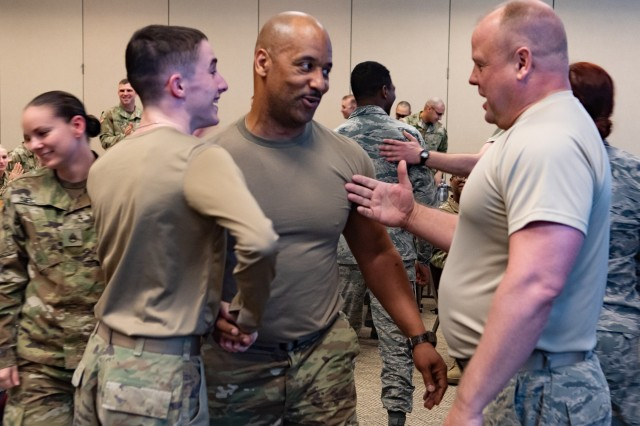 Michigan National Guard Airmen and Soldiers congratulate each other after a push-up competition at the Michigan National Guard Joint Junior Leadership Conference held April 24-26, 2019, at Alpena Combat Readiness Training Center. This is the first time both Michigan Air and Army National Guardsmen, ranks E1-E6, have joined to attend a professional development event like this.