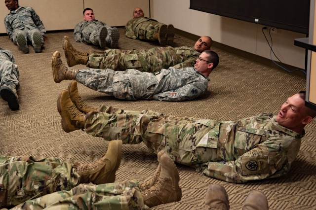 Command Sgt. Maj. Christopher Kepner, Senior Enlisted Advisor to the Chief of the National Guard Bureau, leads Michigan National Guardsmen in flutter-kicks at the Michigan National Guard Joint Junior Leadership Conference held April 24-26, 2019, at Alpena Combat Readiness Training Center. This is the first time both Michigan Air and Army National Guardsmen, ranks E1-E6, have joined to attend a professional development event like this.