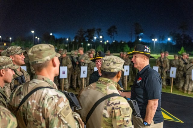 Retired Command Sgt. Maj. William J. Gainey, right, the namesake of the biennial Gainey Cup, speaks to competitors before the Recon Run. Scout teams from across the U.S. Army and foreign militaries take part in the Recon Run as they compete in the fourth biennial Gainey Cup International Best Scout Competition, April 29, 2019, at Braves Rifles Field on Fort Benning, Ga. Scout squads conduct reconnaissance and security in close proximity to enemy forces and civilian populations to provide commanders with fresh, accurate information about the terrain and the enemy. Scouts can rapidly develop their unit's situational awareness, allowing battalions and brigades to concentrate their combat power at the decisive time and place.