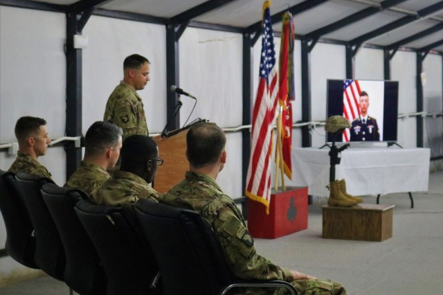 Capt. John Fridlington, 101st Airborne Division, speaks during a memorial service for Spc. Ryan Riley at Qayyarah West Airfield, Iraq, March 25, 2019. (U.S. Army National Guard photo by Sgt. Roger Jackson)