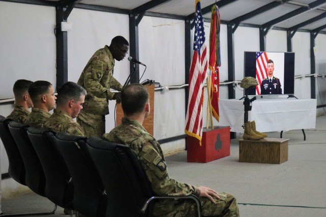 Spc. Chad Williams, 101st Airborne Division, speaks as a close friend of Spc. Ryan Riley during a memorial service at Qayyarah West Airfield, Iraq, March 25, 2019. (U.S. Army National Guard photo by Sgt. Roger Jackson)