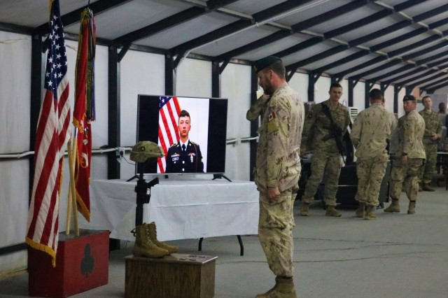 Soldiers of the 101st Airborne Division and other units render honors in respect following the memorial service for Spc. Ryan Dennis Orin Riley at Qayyarah West Airfield, Iraq, March 25, 2019. (U.S. Army National Guard photo by Sgt. Roger Jackson)