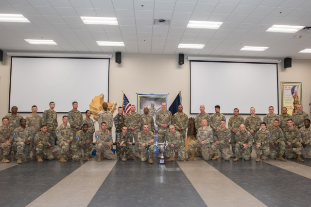Teams from across the Army, who are competing in the 2019 Best CBRN Warrior Competition, pose for a photo with senior leaders of the Chemical Corps Regiment April 29 at Fort Leonard Wood, Missouri. The competition is slated to conclude at noon May 2 on Gammon Field.