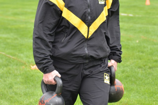 New York Army National Guard, Chief Warrant Officer Five Jackie O'Keefe, Command Chief Warrant Officer carries kettlebells for 50 meters during the sprint, drag, carry event for the Army Combat Test on April 27, 2019, at the Division of Military and Naval Affairs in Latham, N.Y. Major General Ray Shields, the Adjutant General of New York, held a Commanders Call for all New York Army National Guard Brigade and Battalion commanders and command sergeants major to discuss the implementation of the ACFT across the force and to walk the commanders through the process.