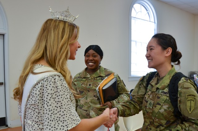 FORT BENNING, Ga. -- Annie Jorgensen, left, the 2018 Miss Georgia, meets with Spc. Crystal Flucas, center, and Pfc. Junghwa Lee, right, at the Fort Benning newcomers brief May 1 at the Army Community Services building. (U.S. Army photo by Bryan Gatchell, Maneuver Center of Excellence, Fort Benning Public Affairs)