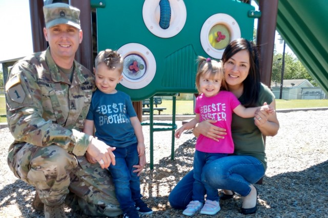 From Left to Right, Sgt. 1st Class Ricky Hill, 504th Expeditionary Military Intelligence Brigade, children and Shoko Hill pose for a family photo, April 26, 2019, Fort Hood, Texas.  The Hills adopted their two children.
