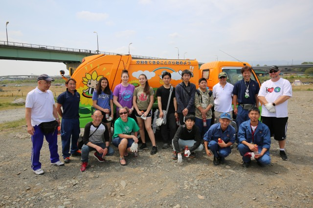 Volunteers pose for a photo after cleaning up about 100 pounds of garbage during a U.S. Army Garrison Japan-sponsored Earth Day event in Zama City on April 21, 2019.