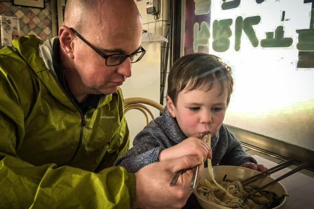 "GYEUNGJU, Republic of Korea -- Maj. Marc Jason, native of Sarasota, Florida, Operations Officer, 1st Battalion, 67th Armor Regiment, 3rd ABCT ""Bulldog,"" 1st AD (Rotational), shares traditional Korean cuisine with his son Owen in Gyeongju, Republic of Korea, April 14. Jason is on a nine-month deployment in support of U.S. Forces Korea, and his wife, Patricia, and son, Owen, made the trip from El Paso, Texas to the Republic of Korea to shorten the distance and strengthen their family bond. (Photo courtesy of Jason Family)"