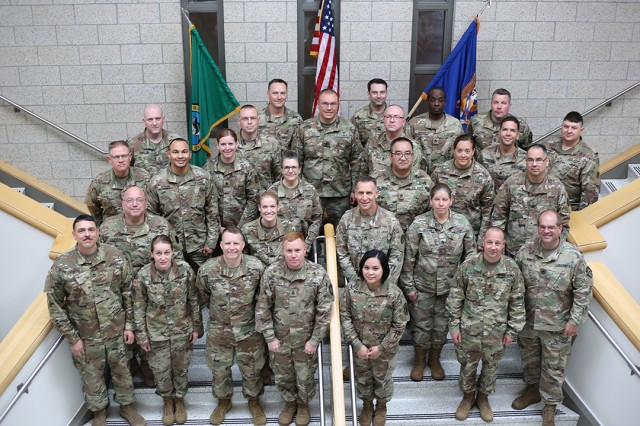 The full-time staff of bands in attendance posed for a photo during the National Guard Army Music Leader Training at Joint Base Lewis-McChord.