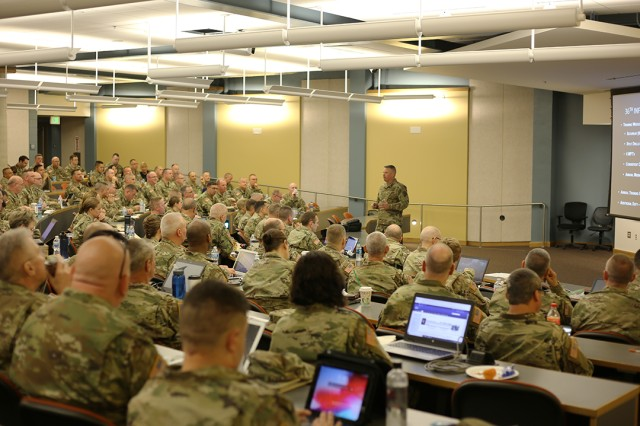 CW3 Jeffrey Lightsey, 36th Infantry Division Band, briefs the music leaders on how he sets up the training year for his band. The conference had several band leaders brief their approach to training as a way to share ideas and collaborate on how best to utilize their Guardsmen.