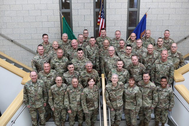 Bandmasters from throughout the United States posed for a photograph during the National Guard Army Music Leader Training at Joint Base Lewis-McChord.