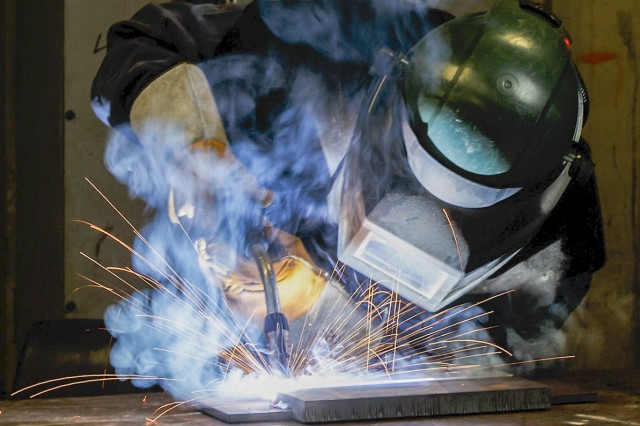 Daniel Rice practices a K-joint weld in one of Anniston Army Depot's welding facilities. Welders had to be certified to perform this type of weld in order to upgrade mine plows for the U.S. Army.