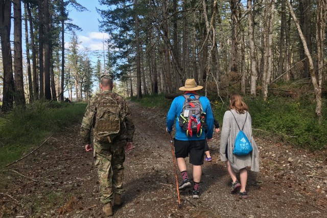 A Soldier walks with two members of the civilian community during the 11th annual Leschi-Quiemuth Honor Walk, April 27 at JBLM.