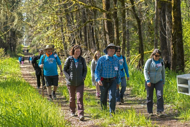 Participants take in the ancestral land of the Nisqually tribe during the 2019 Leschi-Quiemuth Honor Walk at Range 91 on Lewis Main.