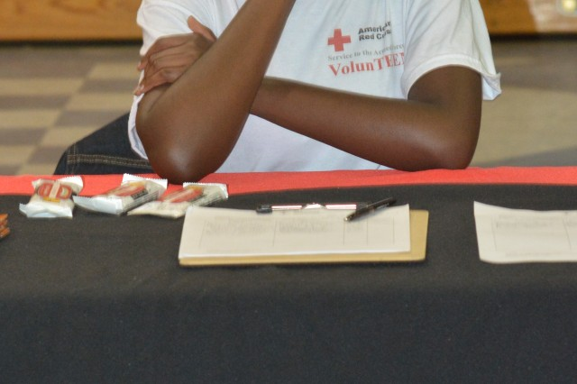 Leah Pierre, left, 17-year-old youth Volunteer of the Year and American Red Cross VolunTEEN president, signs up new volunteers during Family Fun Day April 26.