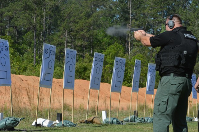 A police officer participating in the ongoing FBI/SWAT tactical training summit on-post practices his tactical shooting skills on the range April 30. The training brings together local, state and federal law enforcement agencies to build relationships and synchronize techniques in preparation for a prospective disaster that numerous entities would need to come together to respond to.