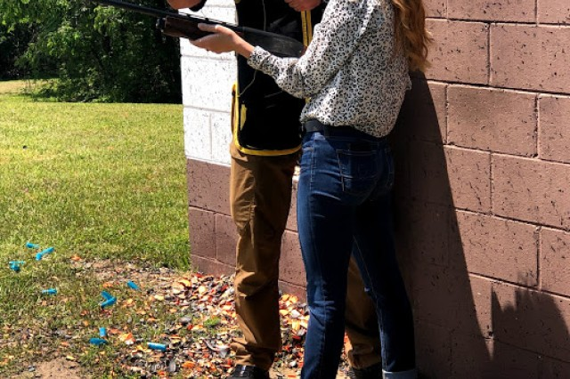 Staff Sgt. Derek Haldeman, U.S. Army Marksmanship Unit, instructs Lauren Augustine, vice president of government affairs for Student Veterans of America and Army Veteran, in the appropriate technique for hitting targets with a shotgun during the influencer's visit to the Army Marksmanship Unit during U.S. Army Recruiting Command's National Educator Tour at Fort Benning, Georgia, April 23-25.