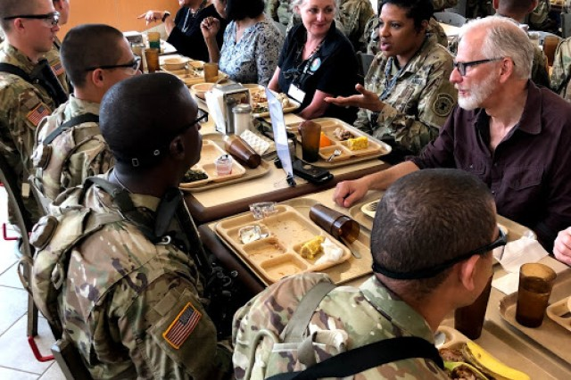 Education influencers and USAREC personnel eat lunch with One Station Unit Training Soldiers during U.S. Army Recruiting Command's National Educator Tour at Fort Benning, Georgia, April 24. This was an opportunity for educators to ask trainees about their experiences and why they chose to join the U.S. Army.