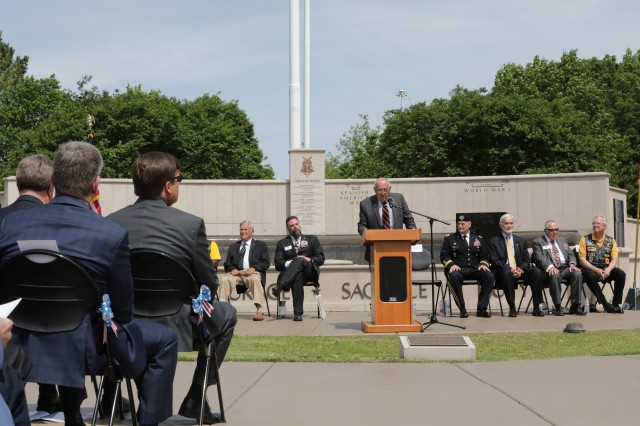 Retired Brig. Gen. Bob Drolet, chairman of the Veterans Memorial Foundation, welcomes attendees of the April 30, 2019, Medal of Honor Wall Rededication Ceremony. Behind him is the Medal of Honor Wall that is part of the Huntsville/Madison County Veterans Memorial. Huntsville, Ala.