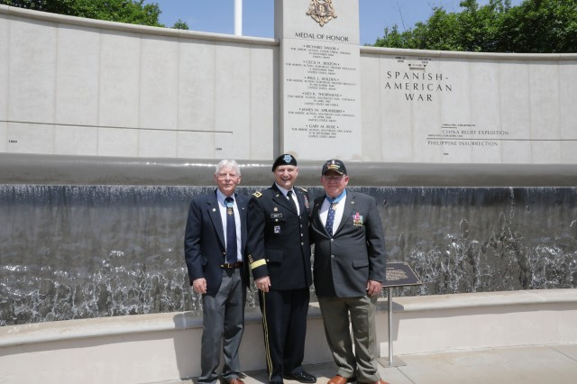 """Lt. Gen. Ed Daly, Redstone Arsenal's senior commander, poses with Medal of Honor recipients Lt. Col. James """"Mike"""" Sprayberry, at left, and Capt. Gary """"Mike"""" Rose following the Medal of Honor Wall Rededication Ceremony. The wall is in the background. April 30, 2019, Huntsville, Ala."""