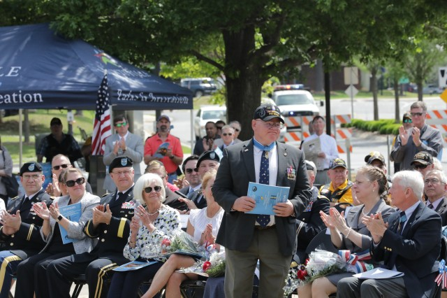 """Retired Capt. Gary """"Mike"""" Rose stands as he is recognized as one of two Medal of Honor recipients whose names have been added to the Huntsville/Madison County Veterans Memorial Medal of Honor Wall. Rose and retired Lt. Col. James """"Mike"""" Sprayberry were honored at the April 30, 2019, Medal of Honor Wall Rededication Ceremony. Huntsville, Ala."""