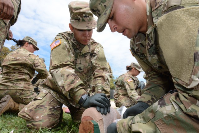 Brigade Combat Team Trauma Training (BCT3) students train on treating and dressing wounds using a simulated appendage.