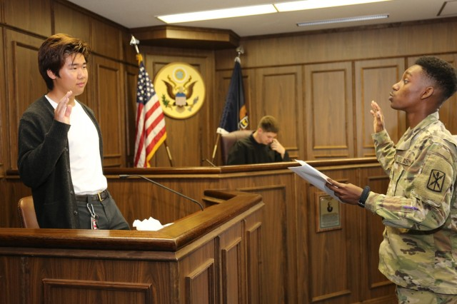 "William Takahashi, a senior at Zama American Middle High School, takes the stand as a witness in a mock trial held April 26 in the U.S. Army Japan courtroom. Takahashi and 15 other ZAMHS seniors participated in the event as part of a ""Law Day"" celebration."