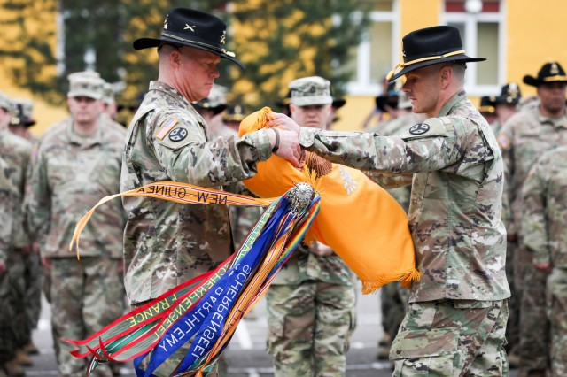 Lt. Col. Timothy Cleveland, Commander (left), and Command Sgt. Maj. Dale Crockette, Command Sergeant Major, of 278th Calvary Regiment, Tennessee Army National Guard (right), case their unit colors here, May 2.