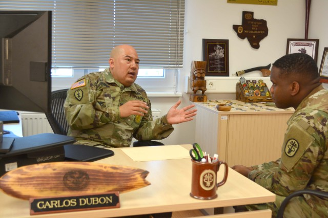 Master Sgt. Carlos Dubon, RHCE senior career counselor, talks with a Soldier about his options for his future in the Army. Dubon provides individual counseling to Soldiers helping to determine their reenlistment eligibility and future career options.