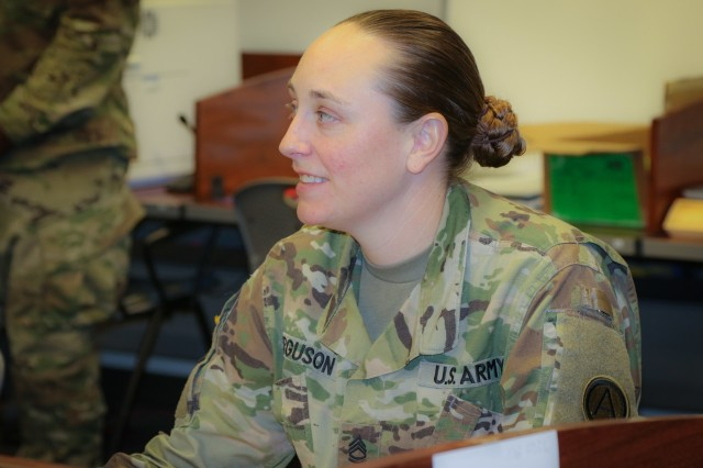 Sgt. 1st Class Heather Ferguson, a signal operations chief at U.S. Army Central, listens to the course instructor during her participation in the Battle Staff Noncommissioned Officers Course at USARCENT headquarters on Shaw Air Force Base, S.C., July 27, 2018. BSNCOC provides technical and tactical curriculum relevant to the missions, duties and responsibilities assigned to battle staff members. (U.S. Army photo by Sgt. Von Marie Donato)