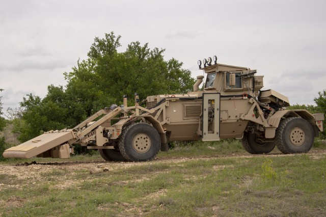 A Husky Mounted Detection System (HMDS) 2 operated by the 937th Engineer Company (Clearance) scans for potential threats during a route clearance patrol using the HMDS 2 as part of an operational test at Fort Hood, Texas. The U.S. Army Operational Test Command (OTC), based at West Fort Hood, Texas, is conducting the combined HMDS & EHP Roller Limited User Test (LUT) to collect data to inform senior Army leaders on how effective, suitable, and reliable the platforms are when used by representative Soldiers in operationally realistic scenarios.