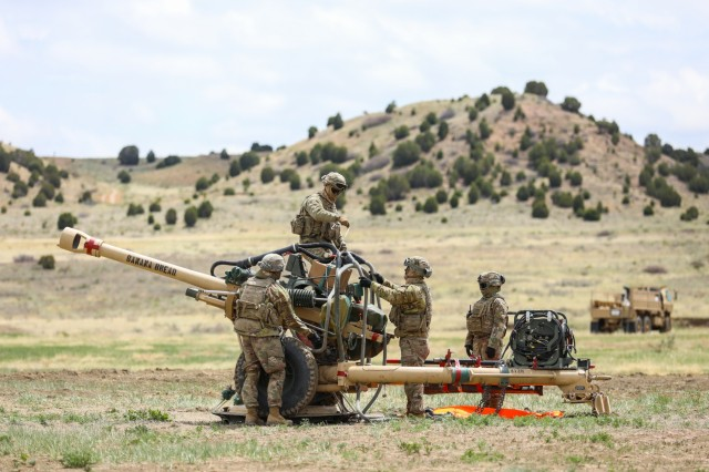 U.S. Army Soldiers assigned to Bravo Battery, 2nd Battalion, 77th Field Artillery Regiment, 2nd Infantry Brigade Combat Team, 4th Infantry Division, prepare a M119 Howitzer, May 2, 2019, during air assault training with Soldiers from the 4th Combat Aviation Brigade, 4th Inf. Div., on Fort Carson, Colorado. (U.S. Army photo by Staff Sgt. Neysa Canfield)