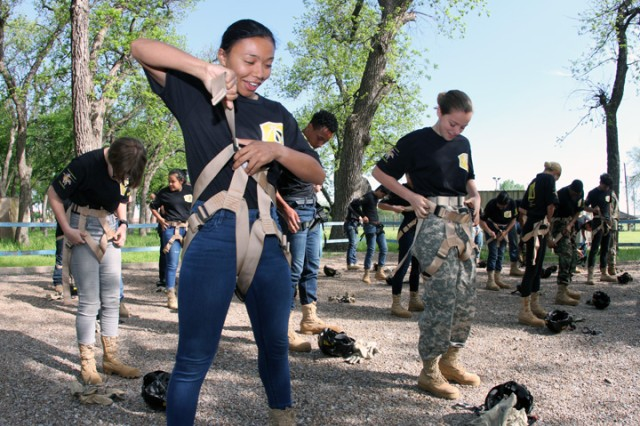 Isabella Shinsako, 17, a junior at Lawton High School, and other Army JROTC cadets learn how to wear a Swiss seat harness.