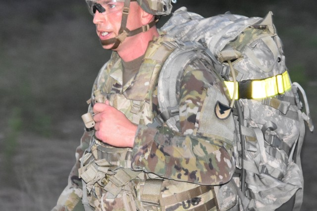 Staff Sgt. Charles Prihoda carries a 35-pound ruck sack and weapon during an 8-mile march as part of the Army Contracting Command 2019 Best Warrior Competition May 1 at Fort Hood, Texas. Prihoda, a contracting NCO from the 901st Contracting Battalion at Fort Hood, is the ACC 2019 Best Warrior of the Year.