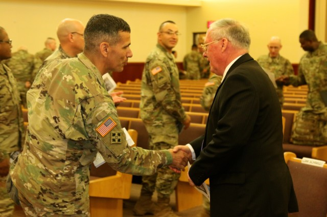 """U.S. Army Col. Andrew Morgado, 2nd Infantry Division Chief of Staff, thanks Col. (Ret.) William Michael Alexander, 2nd Infantry Division/ROK-U.S. Combined Division Museum director and command historian, for speaking during the Days of Remembrance Observance May 2, 2019, Freedom Chapel, Camp Humphreys, Republic of Korea. The 2019 theme for the observance was """"Beyond religions boundaries.""""(U.S. Army photos by Sgt. Kayla Hocker, 20th Public Affairs Detachment)"""
