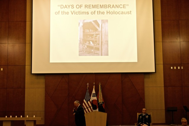 Col. (Ret.) William Michael Alexander, 2nd Infantry Division/ROK-U.S. Combined Division Museum director and command historian, begins his presentation during the Days of Remembrance Observance May 2, 2019, Freedom Chapel, Camp Humphreys, Republic of Korea. Alexander served 30 years as a commissioned officer and studied History and Museum operations at the Smithsonian Institute. (U.S. Army photo by Sgt. Kayla Hocker, 20th Public Affairs Detachment)