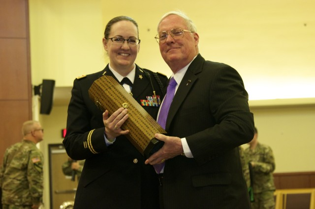 U.S. Army Lt. Col. Laura Bozeman, 2nd Infantry Division Equal Opportunity Program Manager, presents a traditional Korean calligraphy case designed to hold calligraphy brushes and scrolls to Col. (Ret.) William Michael Alexander, 2nd Infantry Division/ROK-U.S. Combined Division Museum director and command historian. The gift was presented in appreciation for preparing a lecture for the Observance.  (U.S. Army photos by Sgt. Kayla Hocker, 20th Public Affairs Detachment)