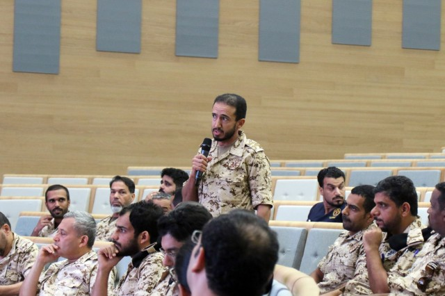 An officer of the Bahrain Defence Force asks a question during a medical subject matter expert exchange at the the Crown Prince Center of Training and Medical Research in Bahrain, April 14, 2019. (U.S. Army National Guard photo by Sgt. Connie Jones)