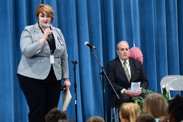 Kingsolver Elementary School Principal Laura Gibson speaks to the students about the importance of Arbor Day prior to Alex Beehler (at right), Assistant Secretary of the Army for Installations, Energy and Environment, delivering his remarks.