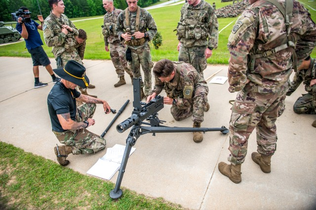 "Members of the 5th Squadron, 73rd Cavalry Regiment, 82nd Airborne Division, assemble and perform a functions test of an M2 machine gun at the Final Charge event. After several days of Cavalry scout-related tasks, 5th Squadron won the fourth biennial Gainey Cup International Scout Squad Competition, May 3, at Brave Rifles Field, on Fort Benning, Ga. The 5th Squadron from Fort Bragg, North Carolina earned the title of ""Best Scout Squad"" against 24 other competing squads from across the U.S. Army and from international partner militaries, including Canada, Germany, Great Britain, and the Netherlands. The Gainey Cup tested the Cavalry scout squads on their ability to perform their job in the field."