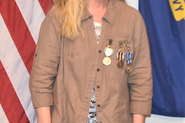 Department of Defense Expeditionary Civilian (DOD-EC) Patricia S. Madaj was awarded the NATO Medal, Global War on Terrorism Medal, a Certificate of Wartime Service and the Public Service Commendation Medal for her service to the Area Support Group-Afghanistan (ASG-A) from May 2018 to May 2019 during a ceremony at Kandahar Airfield (KAF) May 2, 2019. The awards were presented by ASG-A Commander Col. Jacob Peterson.