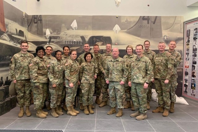 Soldiers of 3rd Legal Operations Detachment, U.S. Army Reserve Legal Command, stand with U.S. Army Europe counterparts during Austere Challenge 2019, a computer-based, command post exercise partnered by U.S. European Command, United Kingdom, and military personnel from 15 North Atlantic Treaty Organization, March 13 to 26. (Photo courtesy of Maj. Andy Scott, 3rd Legal Operations Detachment)