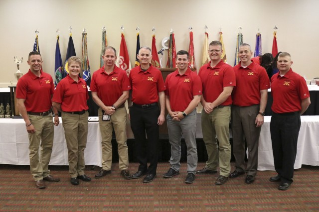 Members of the 130th Field Artillery Brigade take a group photo at the 2019 Joint Conference April 27, 2019. The 2019 Annual Joint Conference, hosted this year by the 235th Regiment, was the 65th annual meeting of the National Guard Association of Kansas and the 47th annual meeting of the Enlisted Association of the National Guard of Kansas and held in Manhattan, Kansas, April. 26-27, 2019.