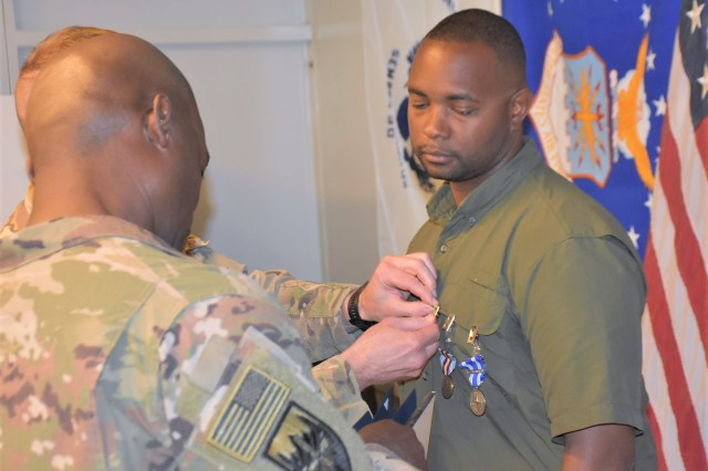 Department of Defense Expeditionary Civilian (DOD-EC) Tristen F. Buckner was awarded the NATO Medal, Global War on Terrorism Medal, a Certificate of Wartime Service and the Public Service Commendation Medal for his service to the Area Support Group-Afghanistan (ASG-A) from May 2018 to May 2019 during a ceremony at Kandahar Airfield (KAF) May 2, 2019. The awards were presented by ASG-A Commander Col. Jacob Peterson.