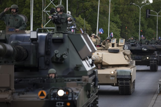 An M1A2 Abrams Tank and crew (middle) from 2nd Battalion, 34th Armored Regiment, 1st Infantry Division from Fort Riley, Kansas, participate in the Poland Constitution Day Parade in Warsaw, Poland, May 3, 2019. Approximately 30 Soldiers from 2nd Bn, 34th Armored Regt., 1st ABCT, 1st ID and four Soldiers from 5th Battalion, 7th Air Defense Artillery out of Baumholder, Germany, took part in Poland's Constitution Day Parade. (U.S. Army photo by Sgt. Thomas Mort)