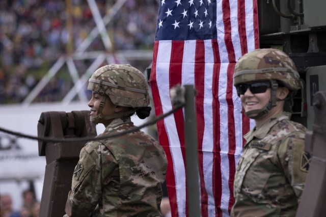 Soldiers from 5th Battalion, 7th Air Defense Artillery out of Baumholder, Germany, smile at the crowd during Poland's Constitution Day Parade in Warsaw, Poland, May 3, 2019. Approximately 30 Soldiers from 2nd Bn, 34th Armored Regt., 1st ABCT, 1st ID and four Soldiers from 5th Battalion, 7th Air Defense Artillery out of Baumholder, Germany, took part in Poland's Constitution Day Parade. (U.S. Army photo by Sgt. Thomas Mort)